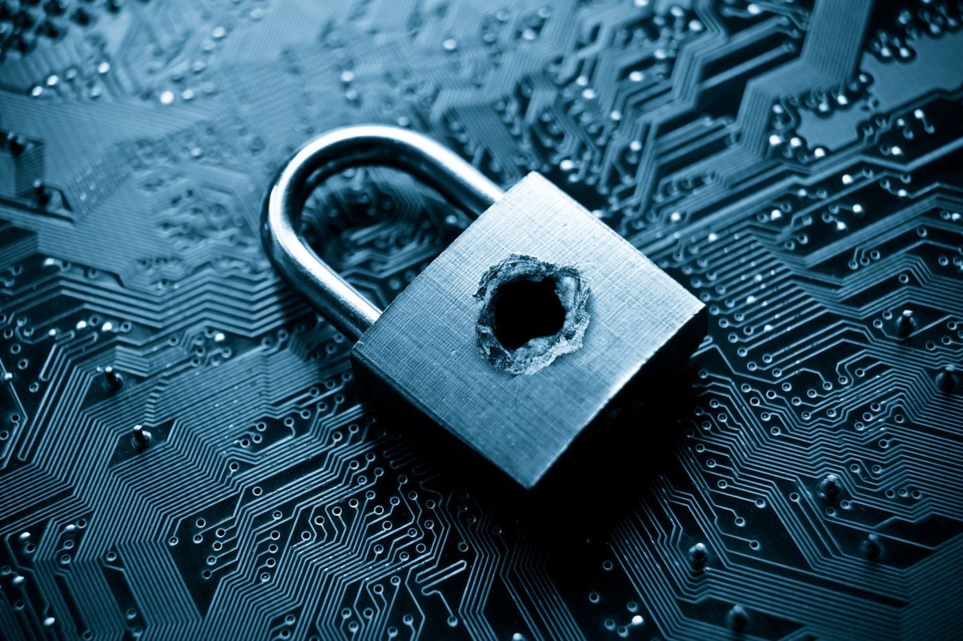 stock-photo-a-penetrated-lock-security-with-a-hole-on-computer-circuit-board-background-275967710