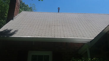 Power washing roof and gables.