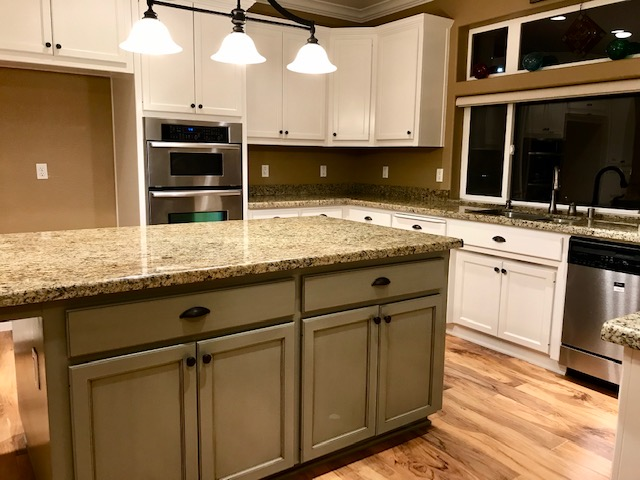 white & soft green cabinets