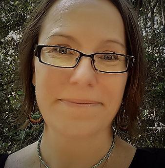 A woman wearing glasses.  Juliette Valentina's profile photo.