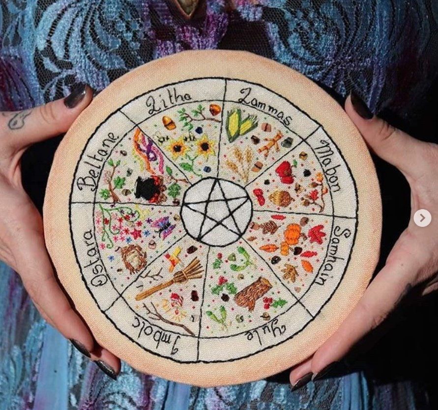 A hand-embroidered Great Wheel of the Year, with a Pinnacle in the centre.  By Ysadora, 2018.