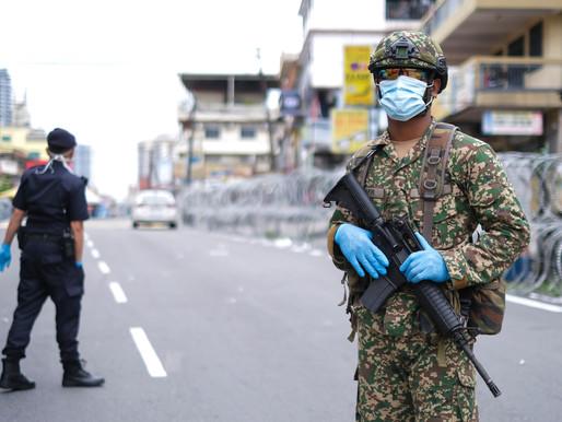 Shares of Top Glove hostel drop as worker put under strict lockdown