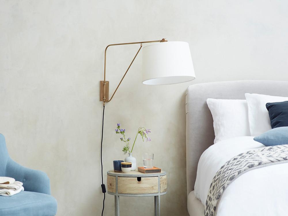 Adjustable brass wall light