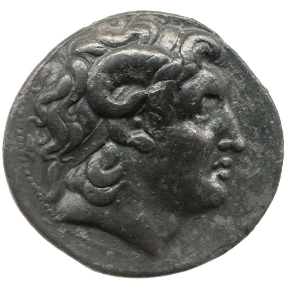 Silver coin with the head of Alexander the Great wearing the horn of Zeus Ammon and diadem. Image from the British Museum.