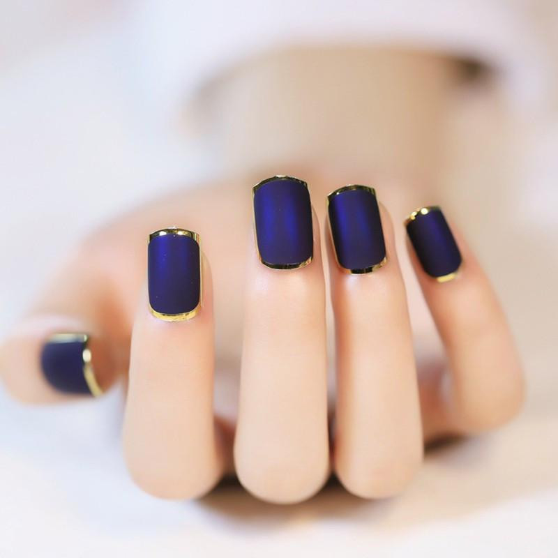False fingernails on a real woman's hand (not a doll, as it appears, but a real woman). Image borrowed from nubiancrownhair.com