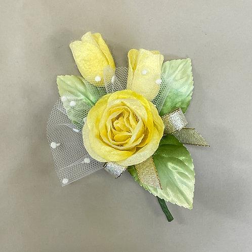 黄色のバラのコサージュ