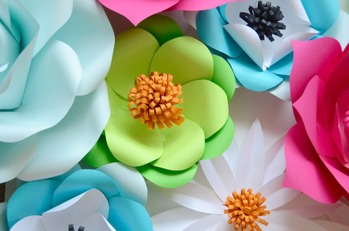 Party backdrops are trending: use paper flowers to dress up yours