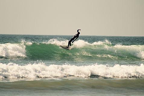 longboard surfing aourir, morocco