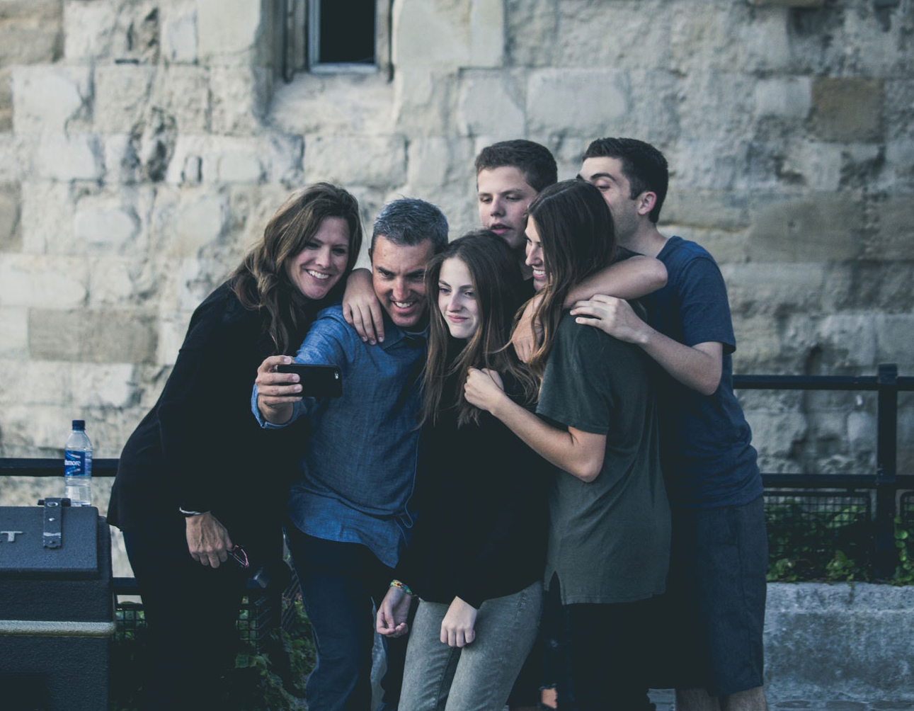 family taking a photo together