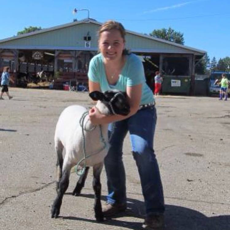 Kristen Broege showing a sheep