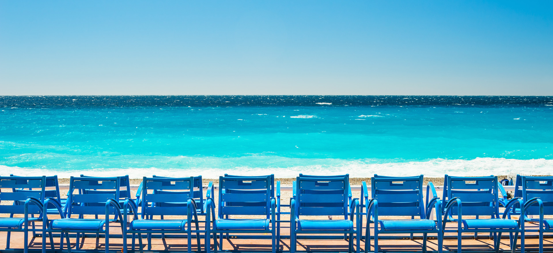 Blue chairs on the Promenade des Anglais