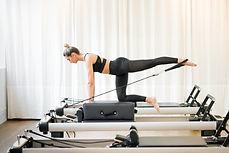 woman-performing-a-pilates-diagonal-stab