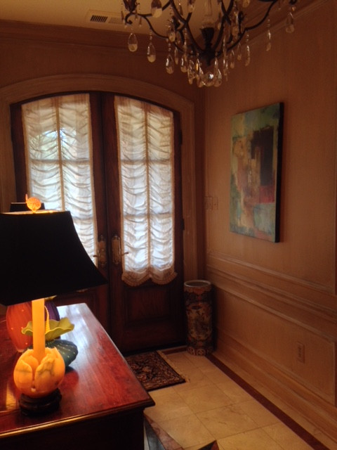 Arched sheer Austrian shades on doors