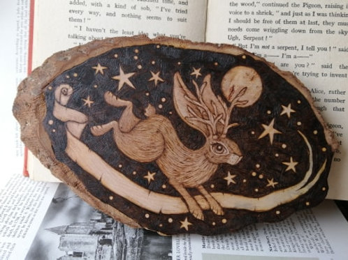 A Leaping Jackalope Against a Night Sky With a Scroll......
