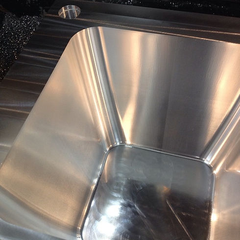 An aluminum injection mold for a bucket.