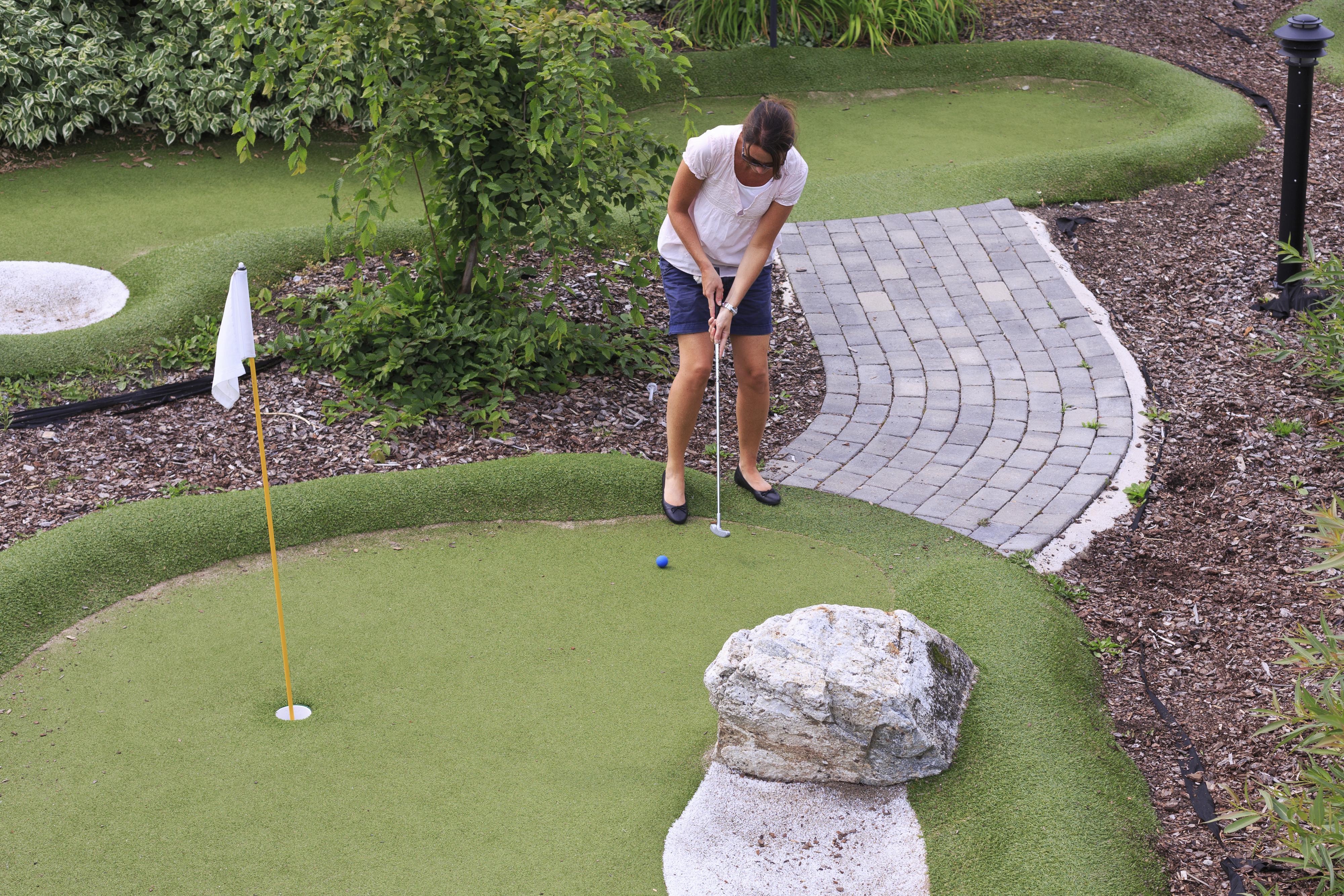 Women playing miniature golf