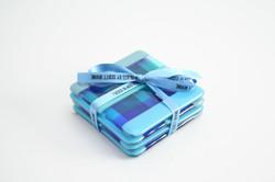 HIW coatsers tied blue