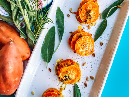 Parmesan and pine nut sweet potato stacks with garlic and herbs