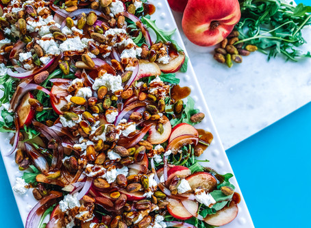 Goat cheese & white peach arugula salad