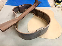 Bent walnut guitar sides, spruce top and mahogany neck