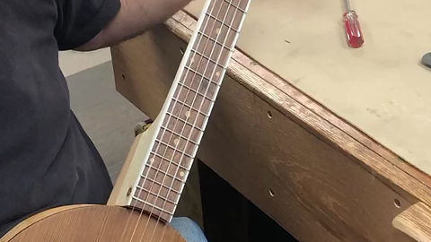Playing one of our custom 5 string banjos made entirely from salvaged lumber