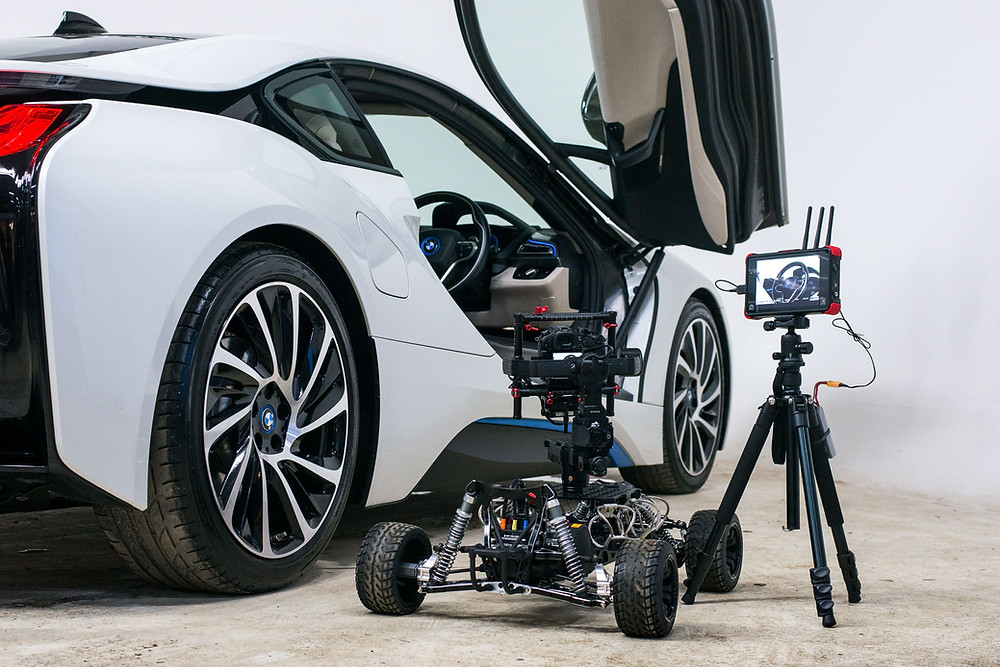 rc camera car with connex and atomos filming a bow i8 car in a studio setting