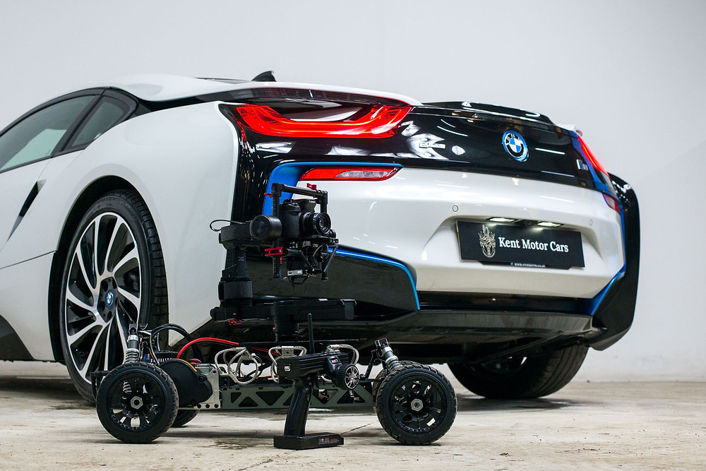 RC buggy with dji ronin filming a bow i8 car in a studio setting