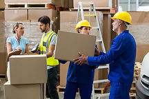delivery-worker-unloading-cardboard-boxe