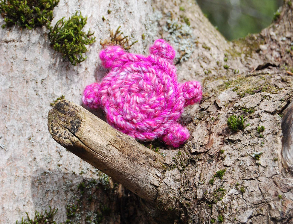 Pink crocheted rose of joy brooch