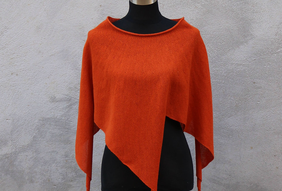 Poppy coloured knitted four winds poncho
