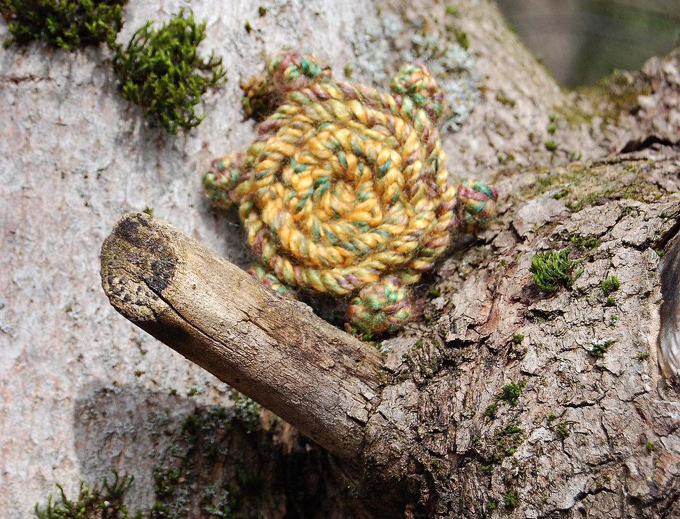 Golden crocheted rose of joy brooch