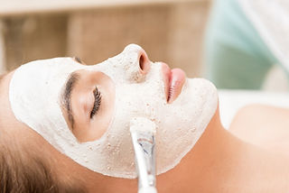 cosmetologist-applying-facial-mask-with-