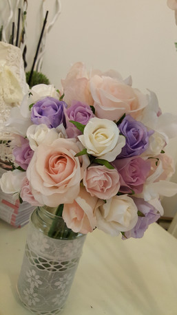 Mauves, Pinks & Coral Roses & Budswith white orchids