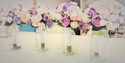 Mauves, Pinks & Coral Roses & Buds with white orchids