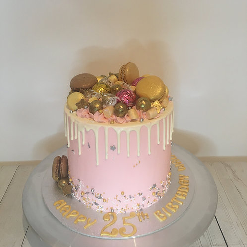 Drip cake with chocolates and macarons 6 inch