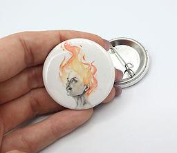 The Fire 1x5 button.jpg