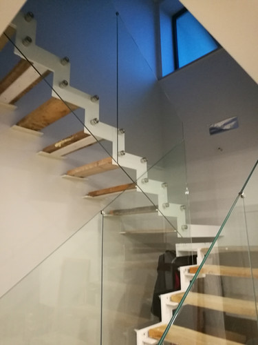 Full-glass railings with point anchorages.