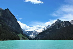 An image of an aqua blue Lake Louise with surrounding mountains