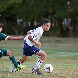 High School Soccer passes fast, capture the action now