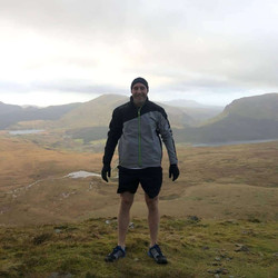 Sometimes I run up mountains for fun! This particularly wet one was Snowdon