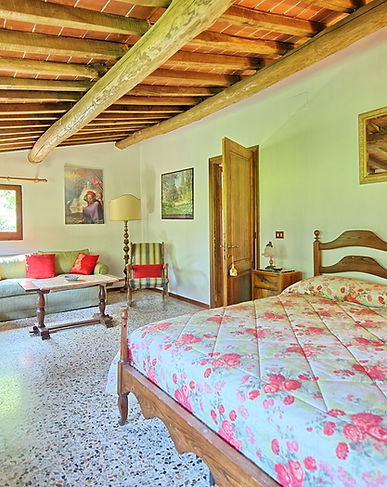 living room of a farmhouse with pool in chianti