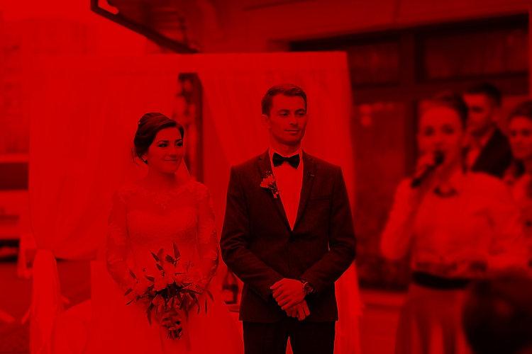 portrait-handsome-groom-putting-wedding-
