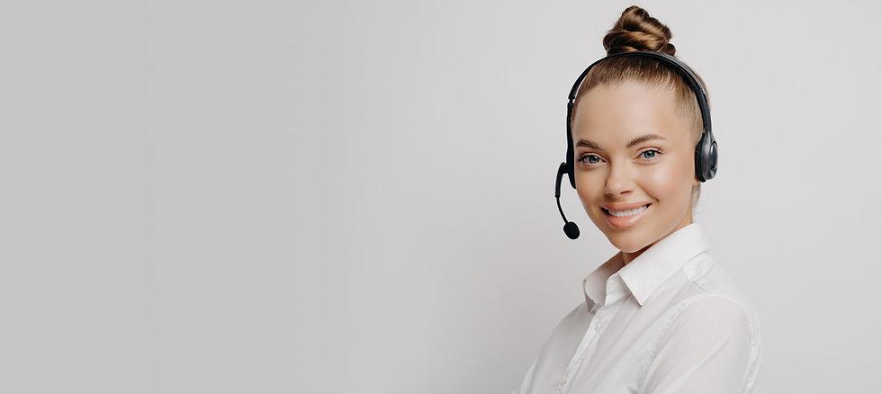 studio-shot-communicative-female-telemarketer-white-shirt-with-wireless-headset-advertisin