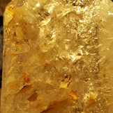 Enhydro (water containing) quartz with keys and gold coloured inclusions (please note: actual piece is clear quartz with gold coloured inclusions and is not yellow throughout) (approximately 12.5cm height)