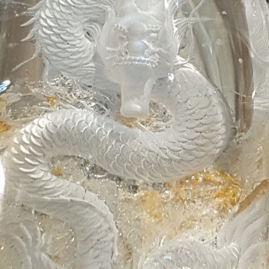 Quartz dragon with gold coloured inclusions (approximately 12 cm long)