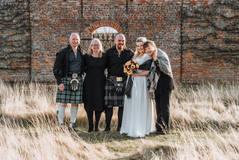 Family Portrait in a regal walled garden