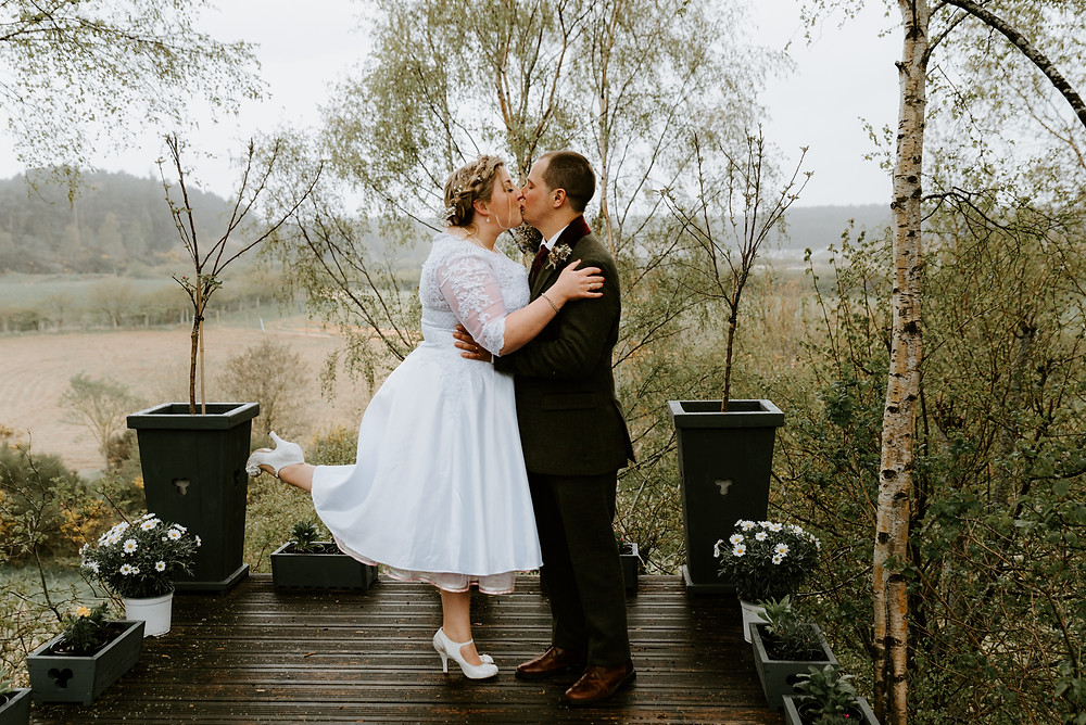 intimate wedding in forres in the scottish highlands. bride and groom kiss