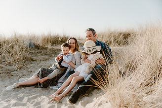 Family sitting in the seagrass at findhorn bay