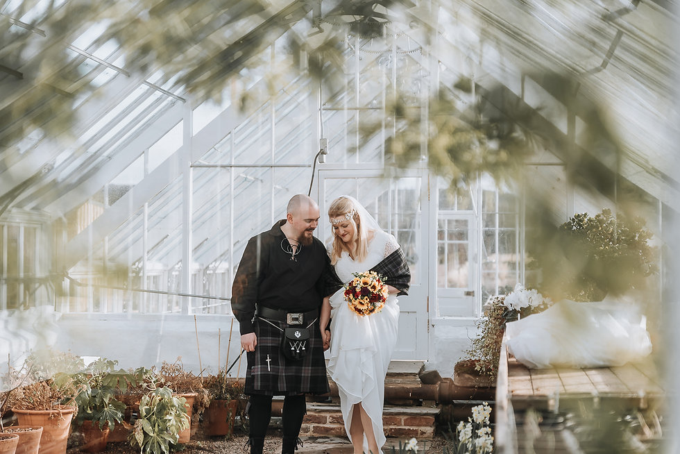 Couple holding hands in greenhouse at gordon castle gardens, moray and aberdeenshire