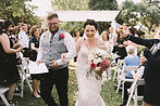 Emma and Aaron showered with petals.jpg